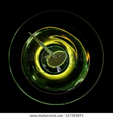 Abstract view and color of cocktail with olive - stock photo