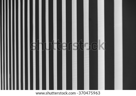 Abstract view of black and white striped wallpaper.  - stock photo