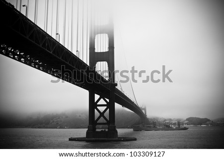 Abstract view of Golden Gate Bridge with battleship below - stock photo