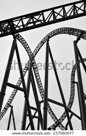 Abstract view of roller coaster track construction background. - stock photo