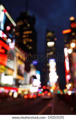 Abstract view of Times Square lights at night - New York City, USA (de-focused to avoid copyright infringements) - stock photo