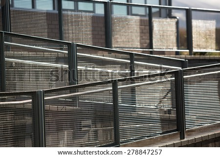 Abstract view of Walkway and Railing in early low sunlight - stock photo