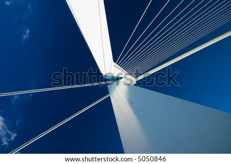 abstract view on big white suspensionbridge cables - stock photo