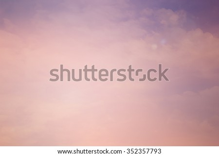 abstract vintage soft clouds and pastel tone color sky backdrop:blurry night dusk focus:blur color sunset/morning background with shine lens flare light:blurry pink and purple concept.sweet wallpaper. - stock photo