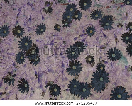 Abstract vintage textured background with a disorderly lot of daisy-shape flowers and abstract strokes (violet tint) - stock photo