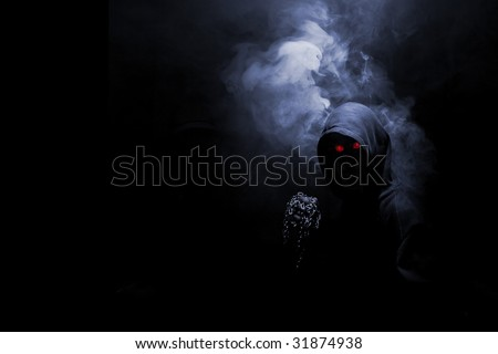 abstract warior with red eyes and metal fist - stock photo