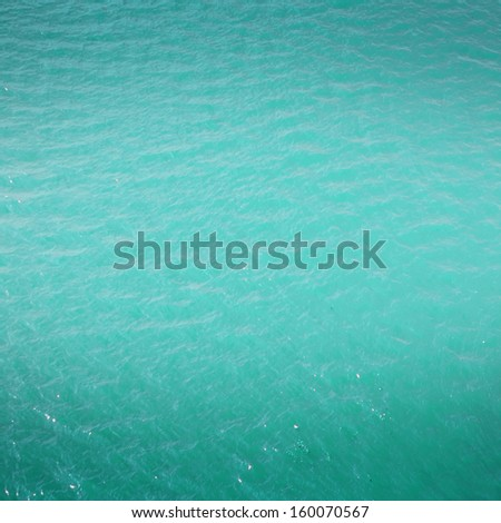 Abstract  water background - bright cyan blue  sea water may use as background or texture. - stock photo