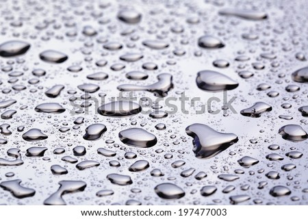 abstract water drops on polished stainless steel surface, close up - stock photo
