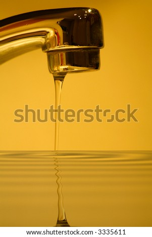 abstract water faucet reflection concept - stock photo