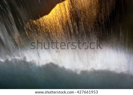 Abstract water flow. Waterfall and light. - stock photo