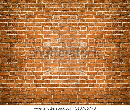 Abstract weathered texture of stained old dark stucco brown and painted red, yellow brick wall background in rural room. Grungy rusty square blocks of darken stonework retro color architect wallpaper. - stock photo