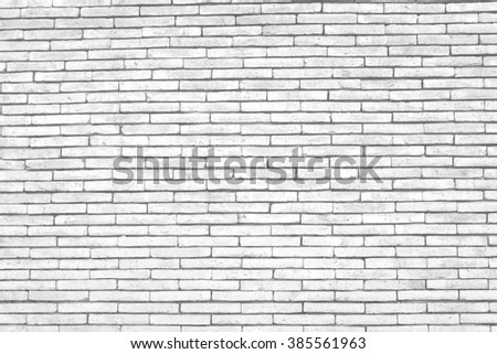 Abstract weathered texture of stained old dark stucco gray and painted white brick wall background - stock photo