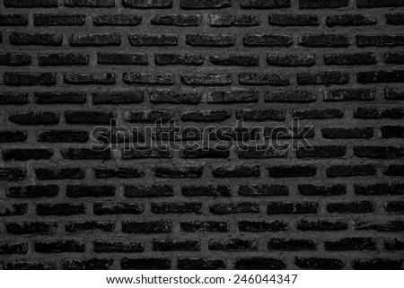 Abstract weathered texture stained old stucco black dark and aged paint vintage brick wall background in rural room, grunge rusty blocks of stonework technology color horizontal architecture wallpaper - stock photo