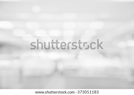 Abstract white and gray bokeh lights background with blurring lights for your design - stock photo