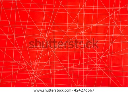 abstract white thread with irregular crossed lines on red background - stock photo