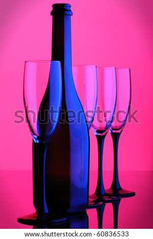 abstract wine bottle and glass pink blue color - stock photo
