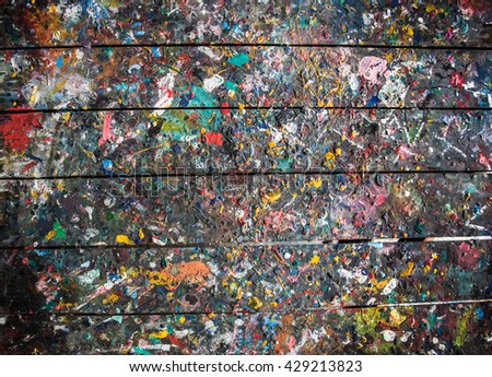 Abstract wooden table with colorful paint spot on the surface. - stock photo
