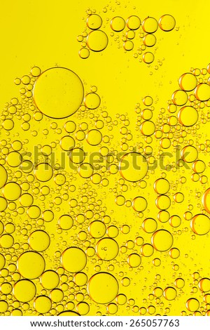 Abstract yellow fluid with bubbles. Water drops. Sparkling fluid. - stock photo