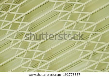 Abstract yellow metal grille sliding door - stock photo