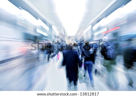 abstract zooming passengers in subway - stock photo