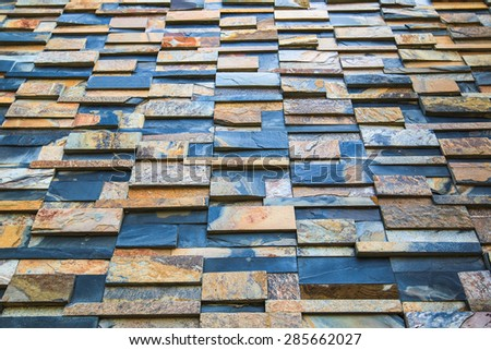 Abstraction from stone tile wall background texture - stock photo