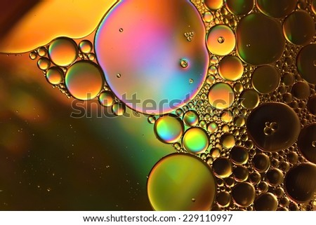 Abstraction, oil colorful bubbles in water. - stock photo