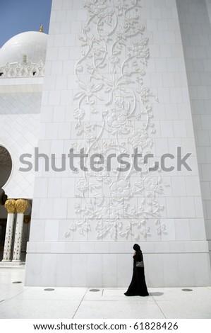 Abu Dhabi Arabian Woman at Sheikh Zayed Mosque - stock photo
