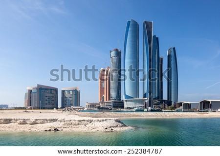 ABU DHABI - DEC 21: Etihad Towers skyscrapers in Abu Dhabi City. December 21, 2014 in Abu Dhabi, United Arab Emirates - stock photo