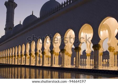 Abu Dhabi Sheikh Zayed Grand Mosque, beautiful walkway at dawn - stock photo