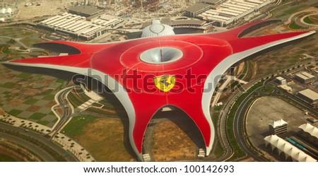 ABU DHABI, UAE -  APRIL 07: Ferrari World Park is the largest indoor amusement park in the world. Abu Dhabi on April 07, 2012. Bird's eye view - stock photo