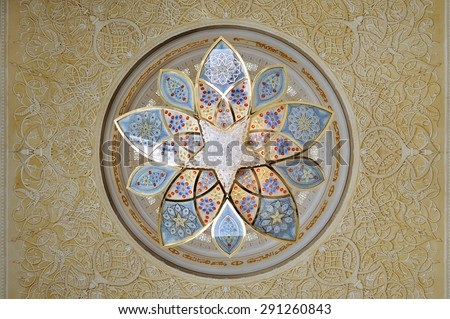 Abu-Dhabi, UAE, April 4 2012. Small chandelier on the ceiling of the Sheikh Zayed mosque in Abu-Dhabi. - stock photo