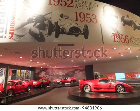 ABU DHABI, UAE - DEC 22: Ferrari car on display at Ferrari World on Yas Island in Abu Dubai in the UAE on December 22, 2011. Ferrari World is the largest indoor amusement park in the world. - stock photo