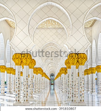 ABU DHABI, UAE - FEBRUARY 08, 2014: Sheikh Zayed Grand Mosque is an architectural wonder of Islamic design with a capacity for over 41,000 worshipers - stock photo