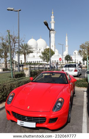 ABU DHABI, UAE - JAN 14: Luxury sportscar parked at the Sheikh Zayed Mosque in Abu Dhabi. January 14, 2012 in Abu Dhabi, United Arab Emirates  - stock photo