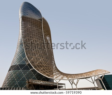 ABU DHABI, UAE - JULY 23: The Capital Gate tower still under construction on July 23, 2010 in Abu Dhabi.  This is certified as the Worlds Furthest Leaning Manmade Tower by Guiness World Records - stock photo