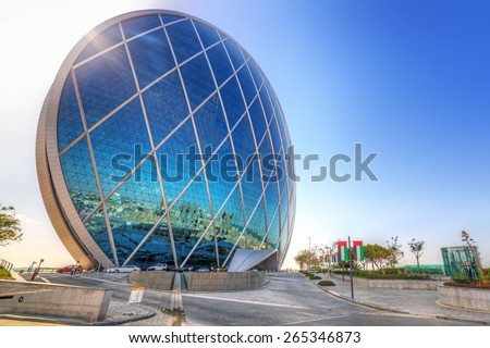ABU DHABI, UAE - MARCH 27: Aldar headquarters building on March 27, 2014, UAE. Aldar headquarters is world first circular building, high for 110m with 61,900 m2 (666,000 sq ft) of floor area. - stock photo