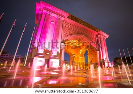 ABU DHABI, UAE - MARCH 26, 2014: Colorful fountain at the gate to Emirates Palace in Abu Dhabi, UAE. Five stars Emirates Palace is the second most expensive hotel ever built for about 6 billion USD. - stock photo
