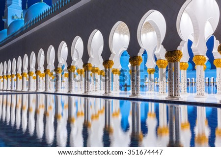 ABU DHABI, UAE - MARCH 27, 2014: Columns of  Sheikh Zayed Grand Mosque in Abu Dhabi, UAE. Grand Mosque in Abu Dhabi is the largest mosque in the United Arab Emirates for more than 40,000 prayers. - stock photo