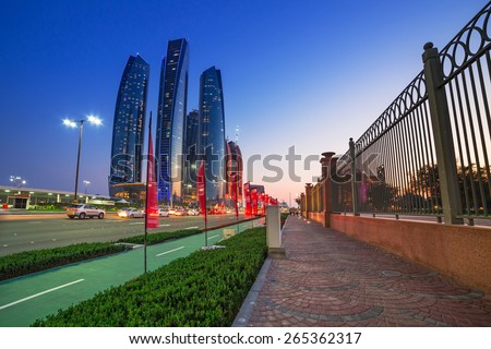 ABU DHABI, UAE - MARCH 28: Etihad Towers buildings in Abu Dhabi on March 28, 2014, UAE. Five towers complex with 74 floors is the third tallest building in Abu Dhabi. - stock photo