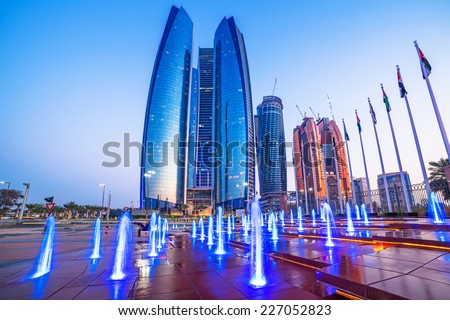 ABU DHABI, UAE - 28 MARCH 2014: Etihad Towers buildings in Abu Dhabi. United Arab Emirates. Five towers complex with 74 floors is the third tallest building in Abu Dhabi. - stock photo