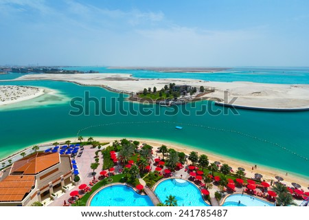 ABU DHABI, UAE - MARCH 25: Pool area of Khalidiya Palace by Rotana on March 25, 2014, UAE. Rotana Hotel Corporation has 85 properties in 26 cities around Middle East and Africa. - stock photo