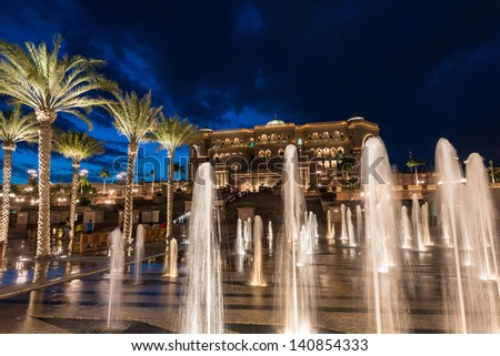 ABU DHABI, UAE - MAY 1: Emirates Palace hotel with fountain on May 1, 2013. Emirates Palace is a luxurious and the most expensive 7 star hotel designed by renowned architect, John Elliott RIBA. - stock photo