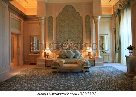 ABU DHABI, UAE - MAY 26: Palace suite bedroom interior of Emirates Palace hotel on May 26, 2011. Emirates Palace is a luxurious 7 star hotel designed by renowned architect, John Elliott RIBA. - stock photo