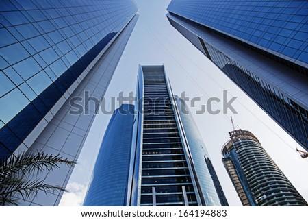 ABU DHABI, UAE - NOVEMBER 5: Modern buildings in Abu Dhabi, on November 5, 2013, Abu Dhabi, UAE. It is the capital of the United Arab Emirates. - stock photo