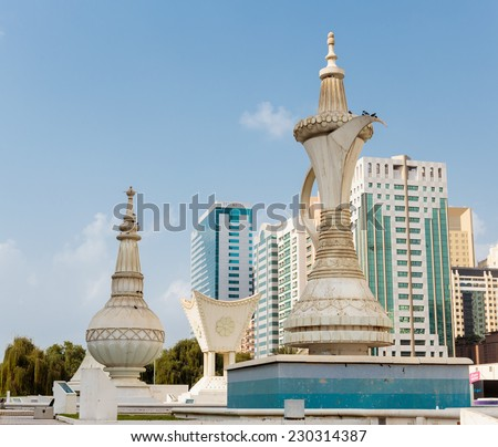 ABU DHABI, UAE - NOVEMBER 5: Monument of the Al-Ittihad Square on November 5, 2013 in Abu Dhabi, UAE. Abu Dhabi is aiming to become one of the cultural capitals of the world. - stock photo