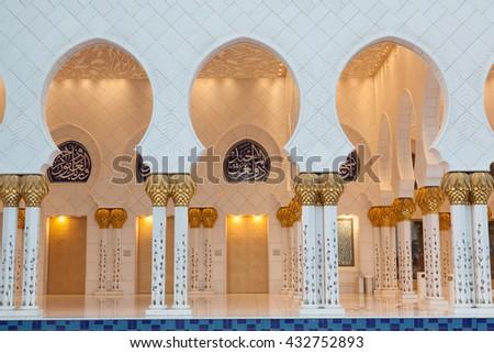 Abu Dhabi, United Arab Emirates - February 4,2012: The beautiful white and gold Grand Sheikh Zayed Mosque at sunset, Abu Dhabi, United Arabic Emirates - stock photo