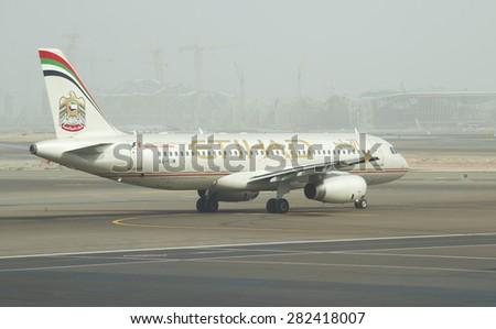 ABU DHABI, UNITED ARAB EMIRATES - MARCH 10, 2015: Passenger aircraft Airbus A318-321 Etihad Airways before takeoff - stock photo