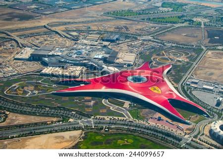 ABU DHABI, UNITED ARAB EMIRATES - MAY 23, 2013: Aerial view of Ferrari World Park is the largest indoor amusement park in the world. - stock photo