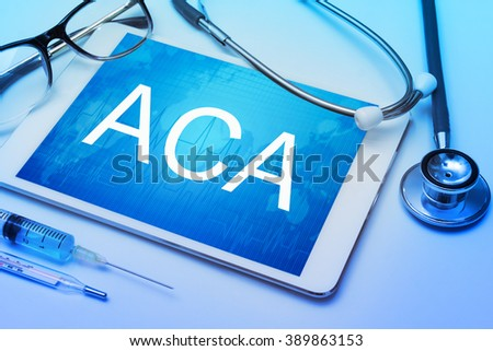 ACA word on tablet screen with medical equipment on background - stock photo