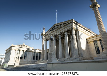 Academy of Athens, on the sides of which are two Ionic columns with statues of Athena and Apollo  - stock photo